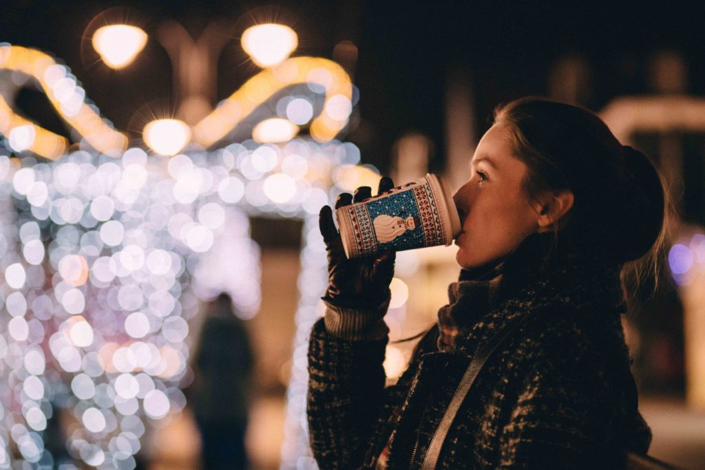 A lady sipping coffee in winter