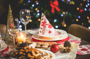 Table at a Christmas party with a wine glass and food