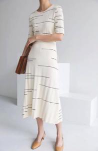 Woman in striped dress.