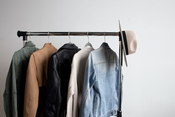 Clothes and a hat on a rack